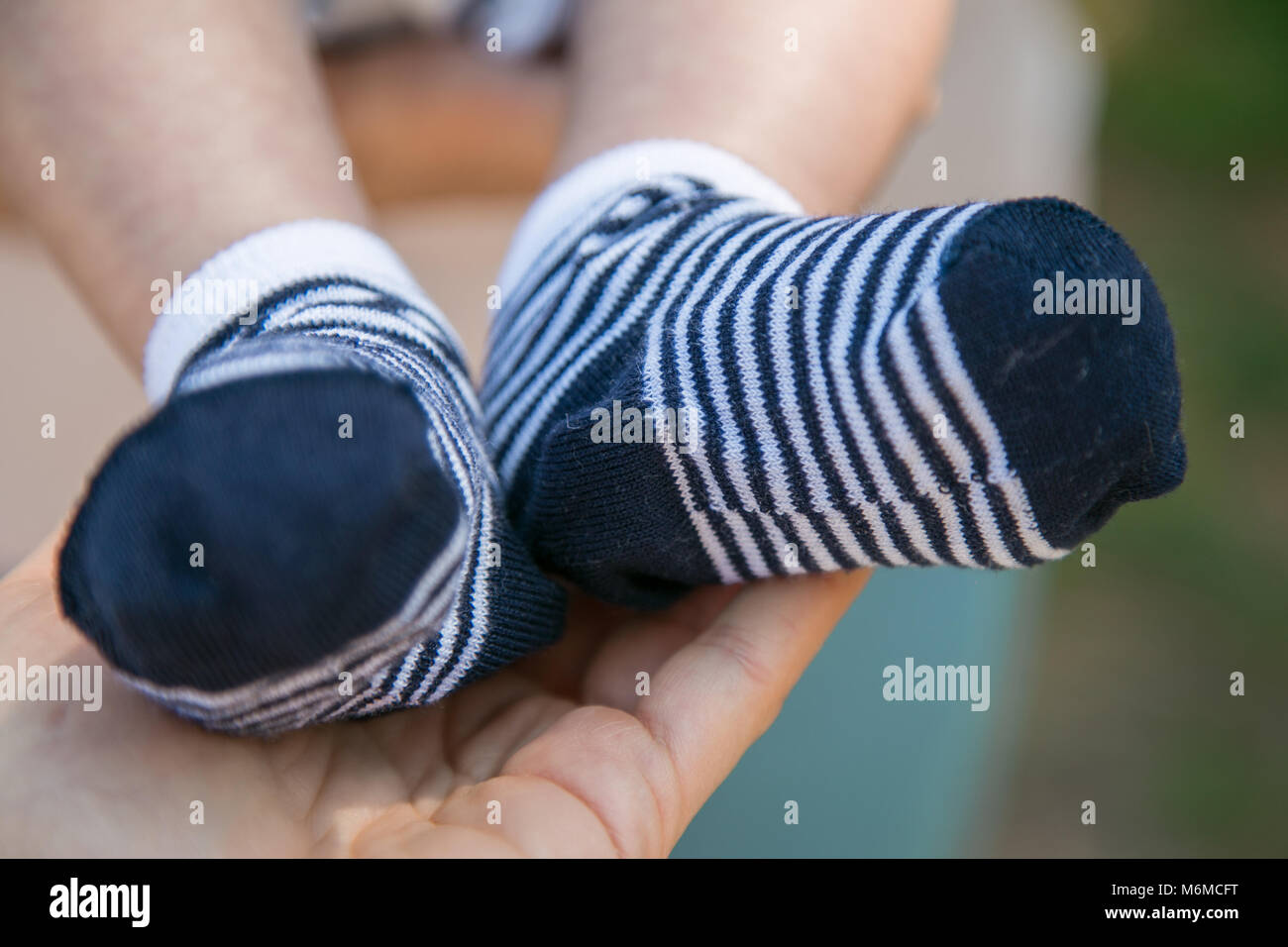 Child S Feet Detail With White And Blue Socks In His