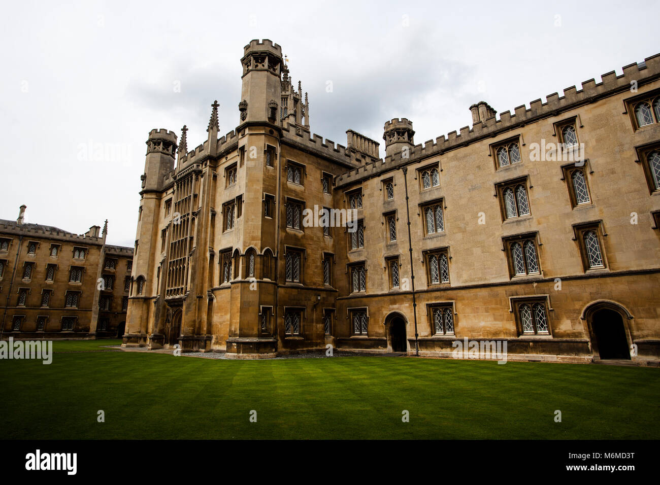 Trinity College buildings and grass in Cambridge University - Stock Image