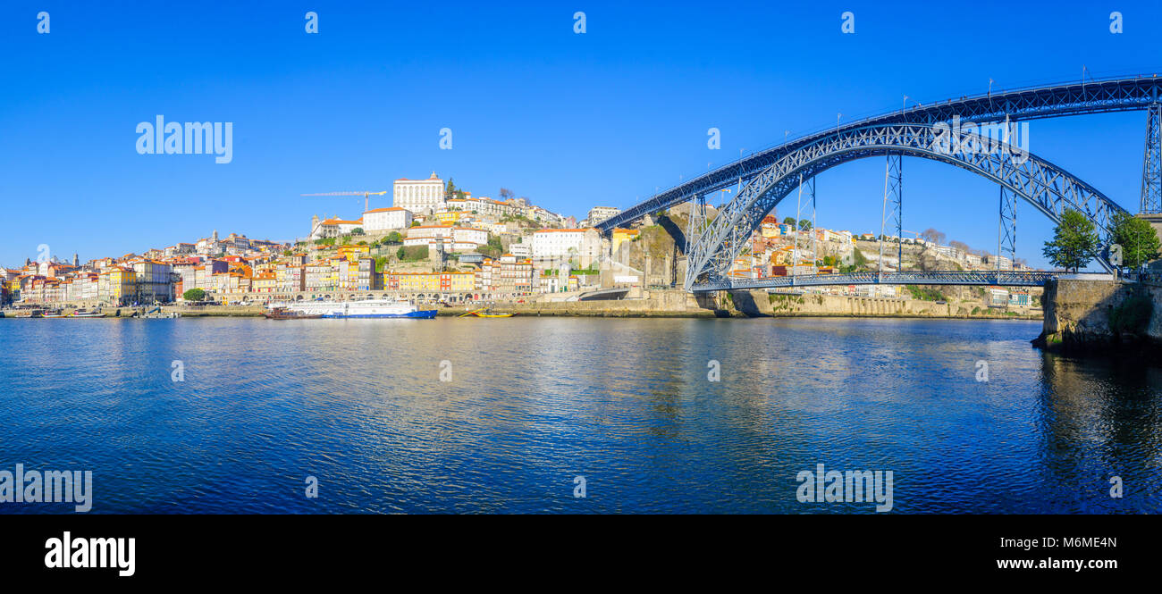 Panoramic view of the Dom Luis I Bridge, the Douro river and the Ribeira (riverside), with colorful buildings, in Stock Photo