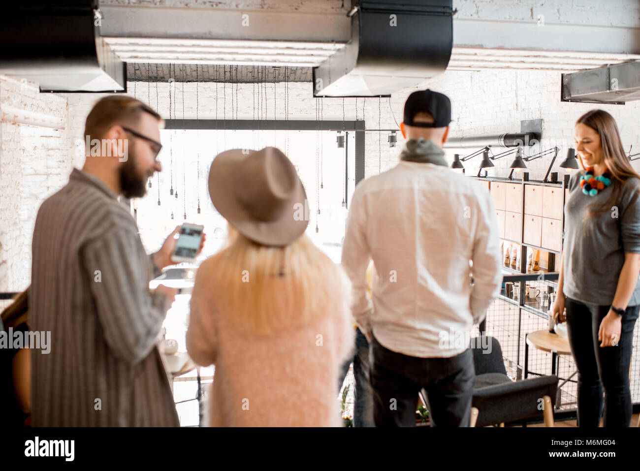People talking indoors, no focus - Stock Image