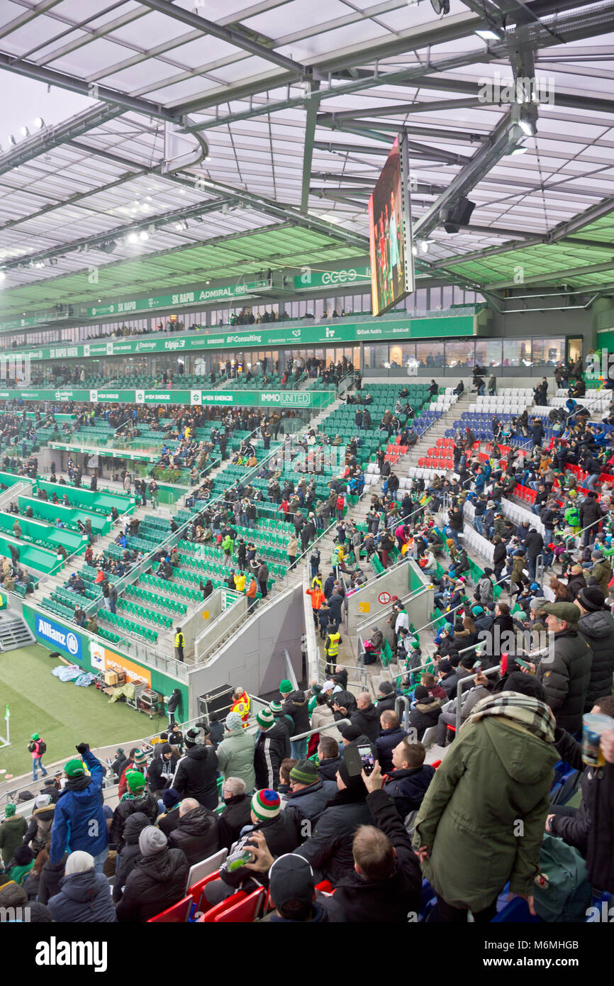 People attending a game of Austrian Bundesliga at Allianz Stadion in Vienna before the football match Rapid Wien - Stock Image