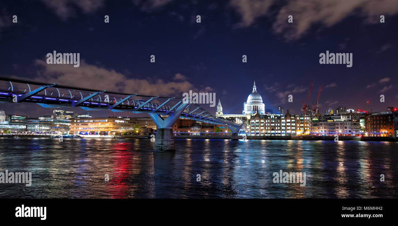 St Paul's Cathedral , the river Thames and the Millennium Bridge at night. London cityscape, showing illuminated - Stock Image