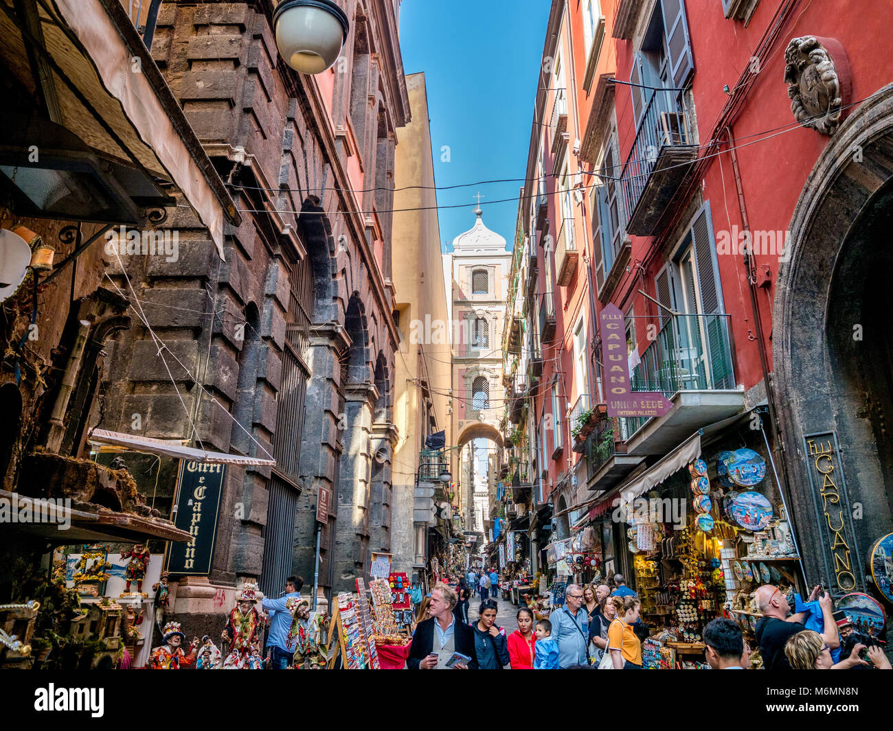 Narrow tourist street with gift shops in Naples, Italy. - Stock Image