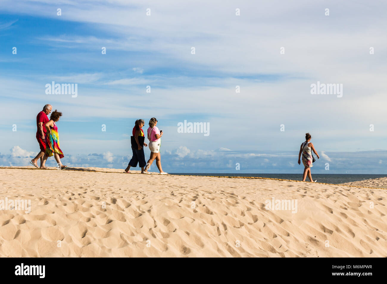 Punta Del Este, Uruguay - February 28th, 2018: People walking in the beach to visit La Mano, the sculpture made Stock Photo