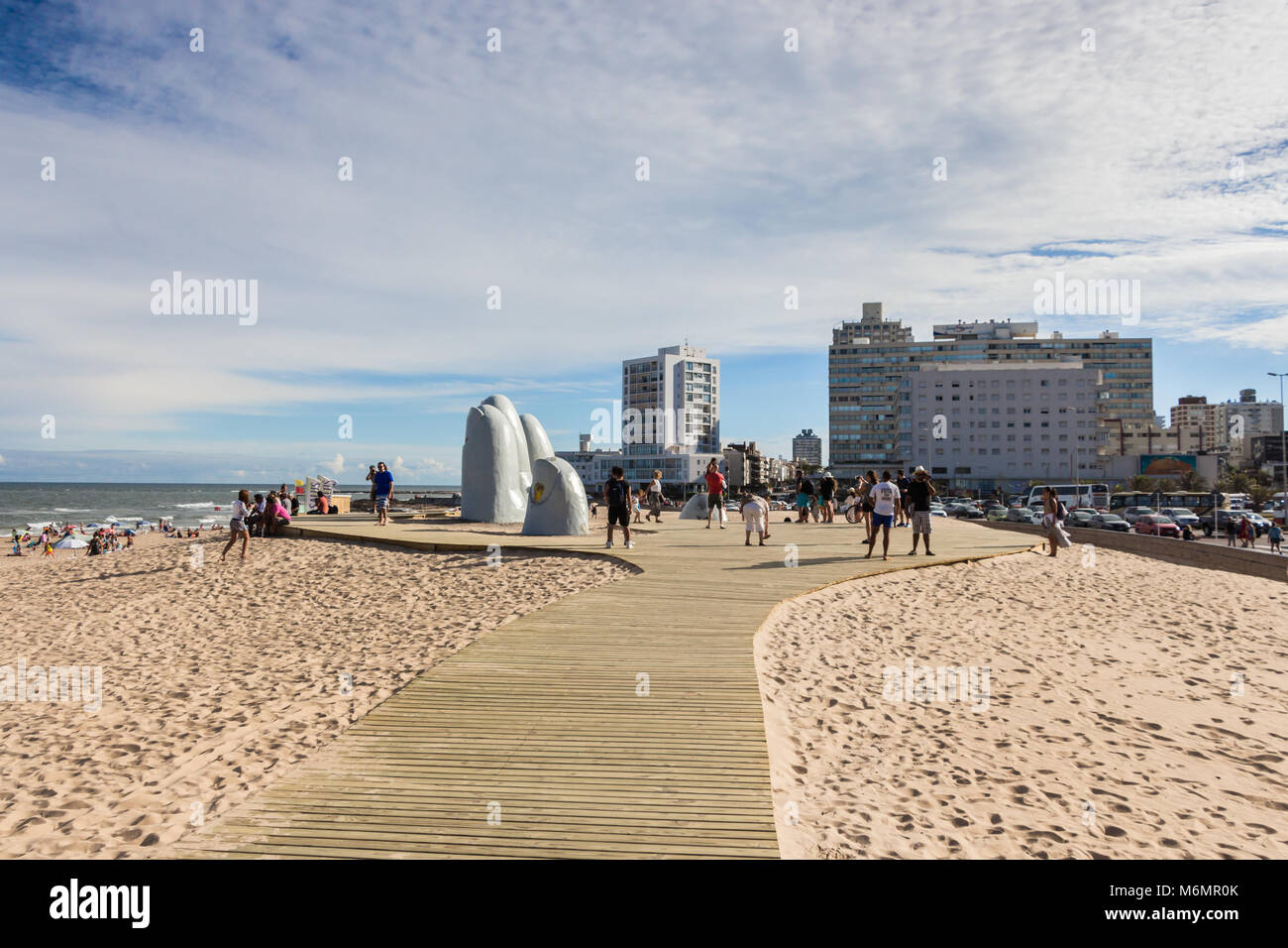 Punta Del Este, Uruguay - February 28th, 2018: People taking photos and sefies at La Mano, the sculpture made by Stock Photo