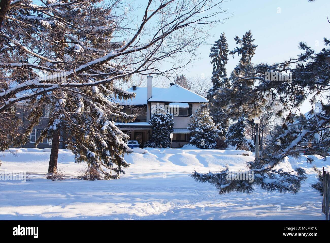 A snow covered house and winter street scene in Ottawa, Ontario, Canada. - Stock Image