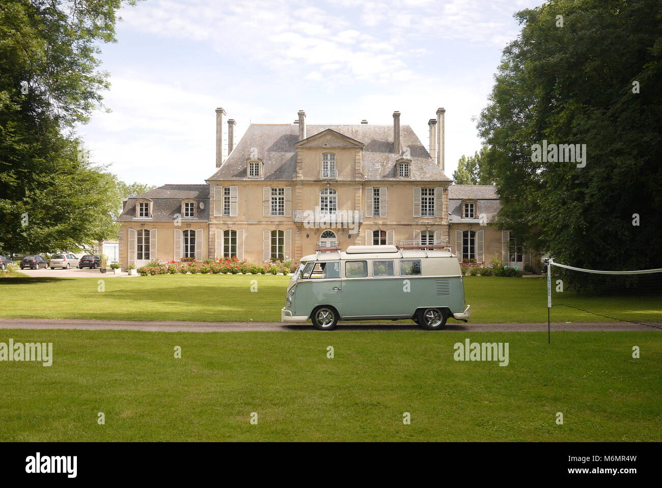 Camp site in France. Camping in a VW van traveling through France. The two blend very well. - Stock Image