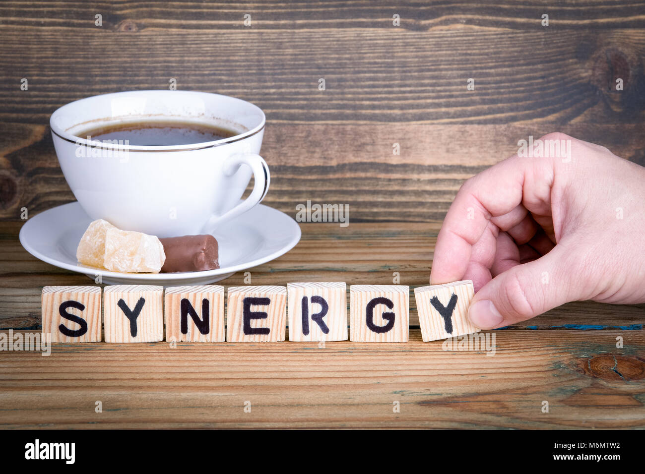 synergy. Wooden letters on the office desk, informative and communication background Stock Photo