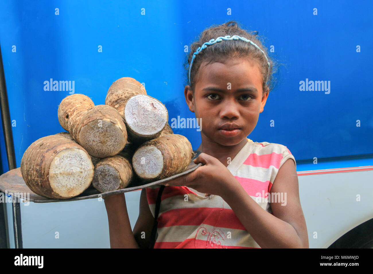 Africa, Madagascar, Portrait of young food vendor - Stock Image
