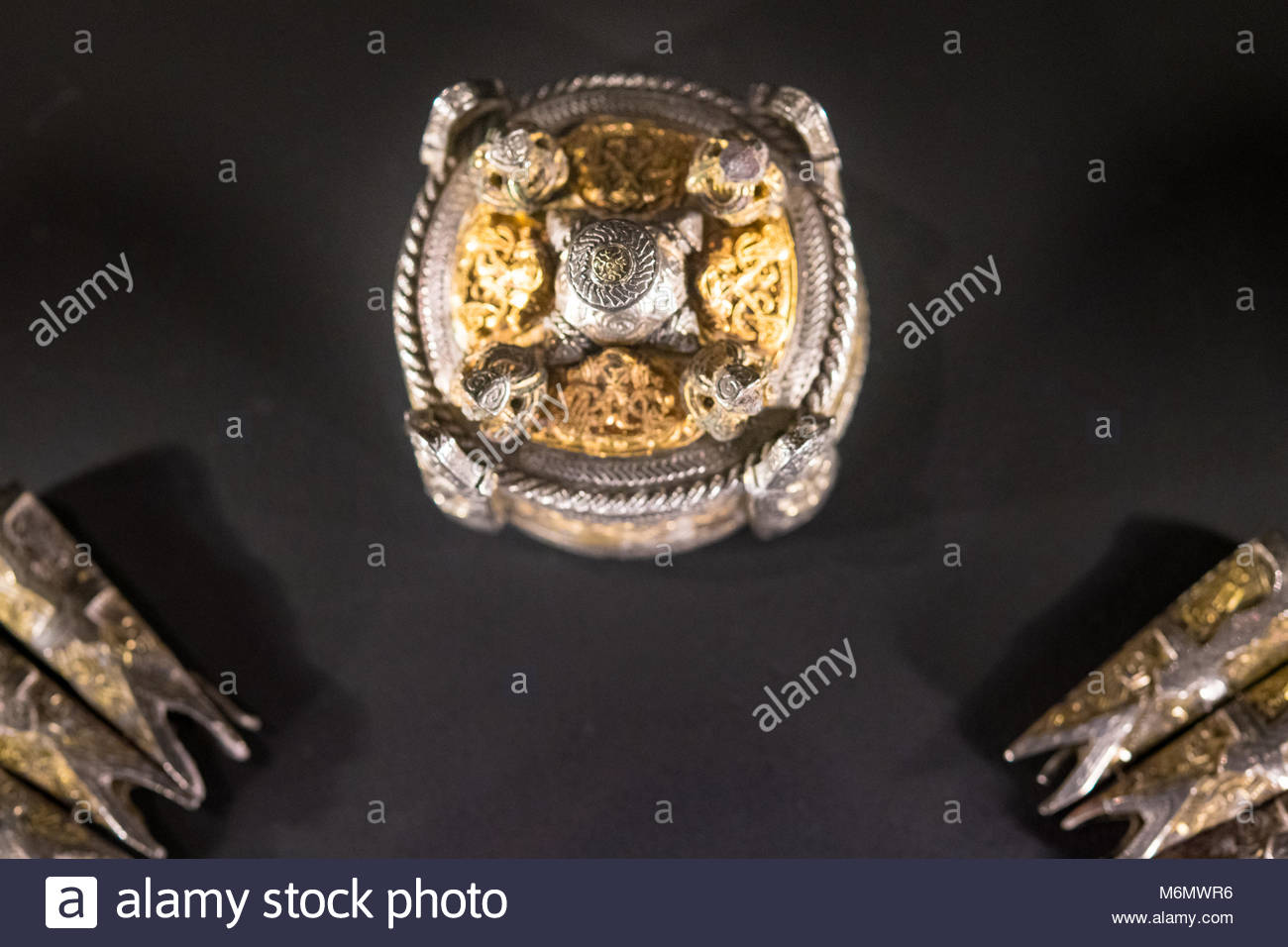 The Vikings objects: brooch made of gold, silver, and bronze. The Vikings were Norse people who raided and traded - Stock Image
