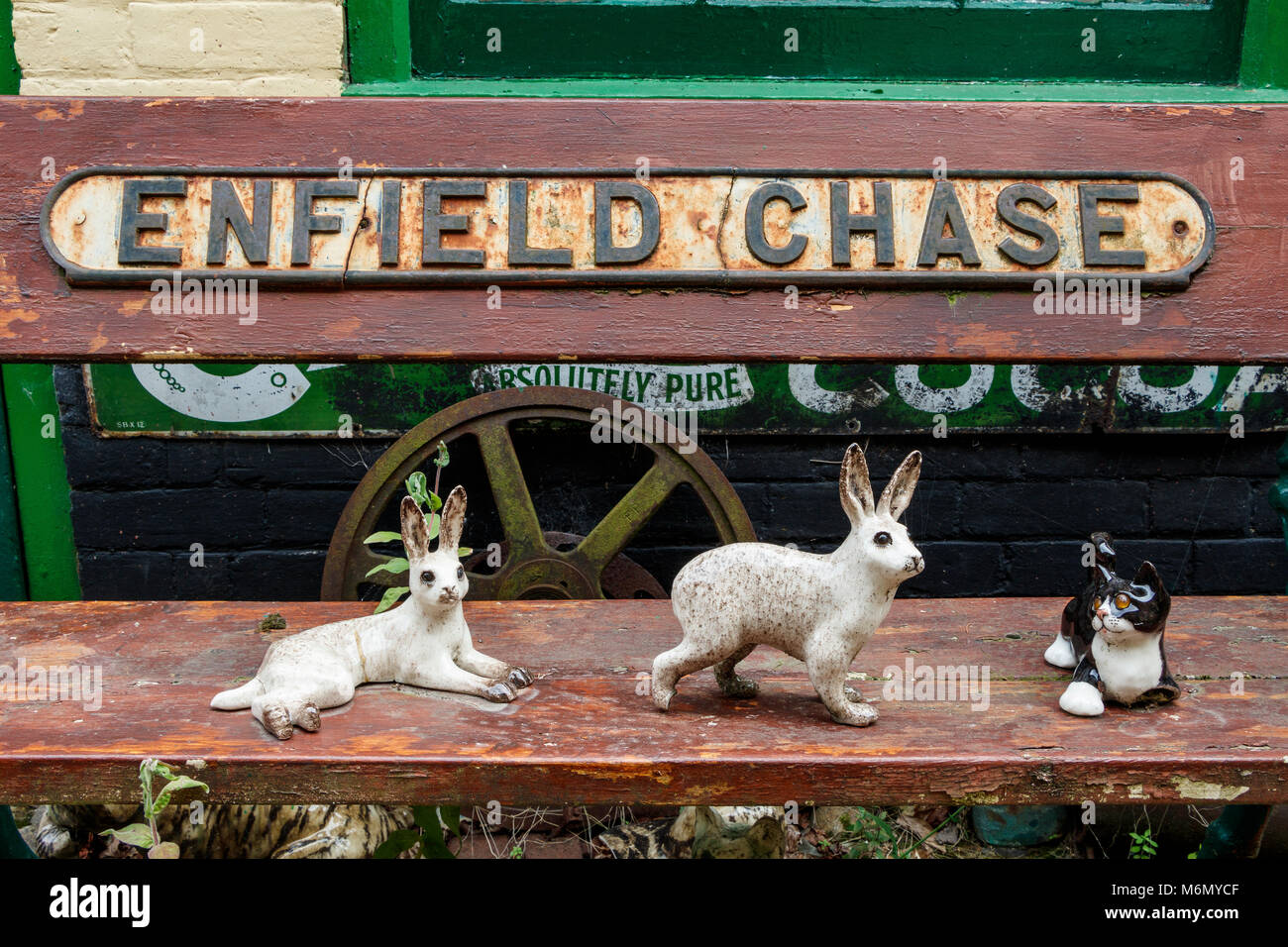 A collection of Winstanley pottery cats and rabbits arranged outdoors. North Walsham, Norfolk, UK. - Stock Image
