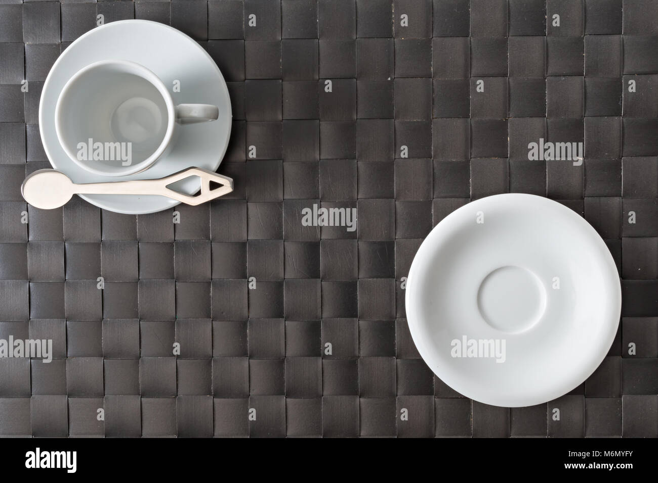 empty coffee cup with placemat of synthetic material shot from above breakfast concept - Stock Image