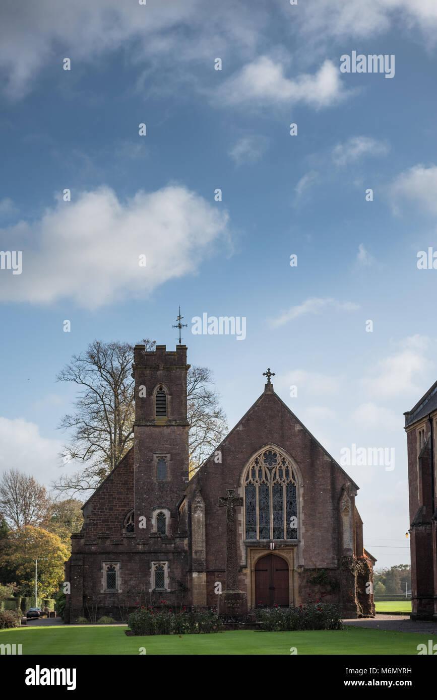 Blundell's School chapel under a blue sky - Stock Image