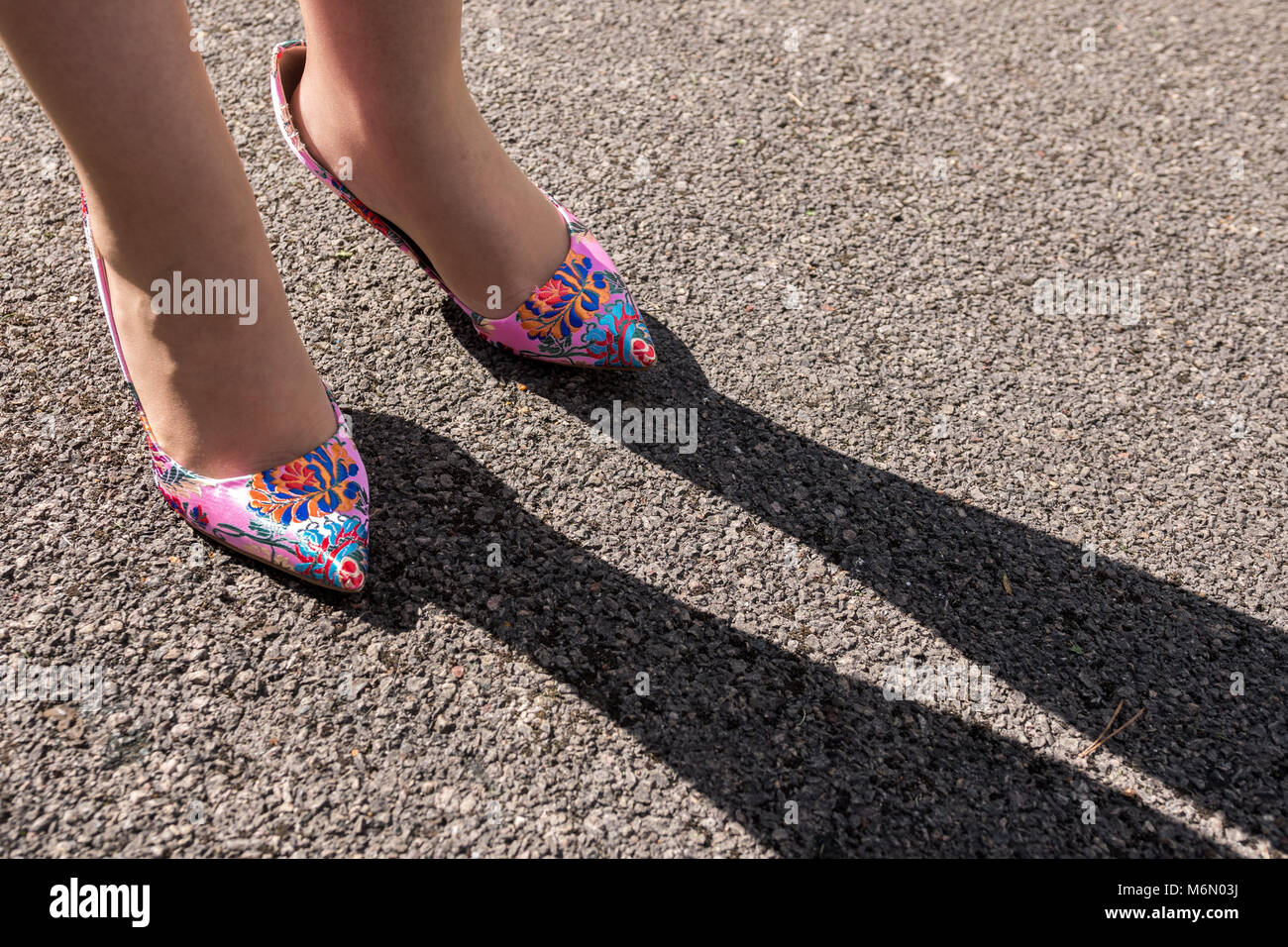 Ladies colourful high heeled shoes creating shadow - Stock Image