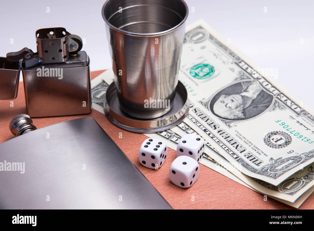 alcohol flash cigard lighter matches zippo glass dice dollar bill wood texture - Stock Image