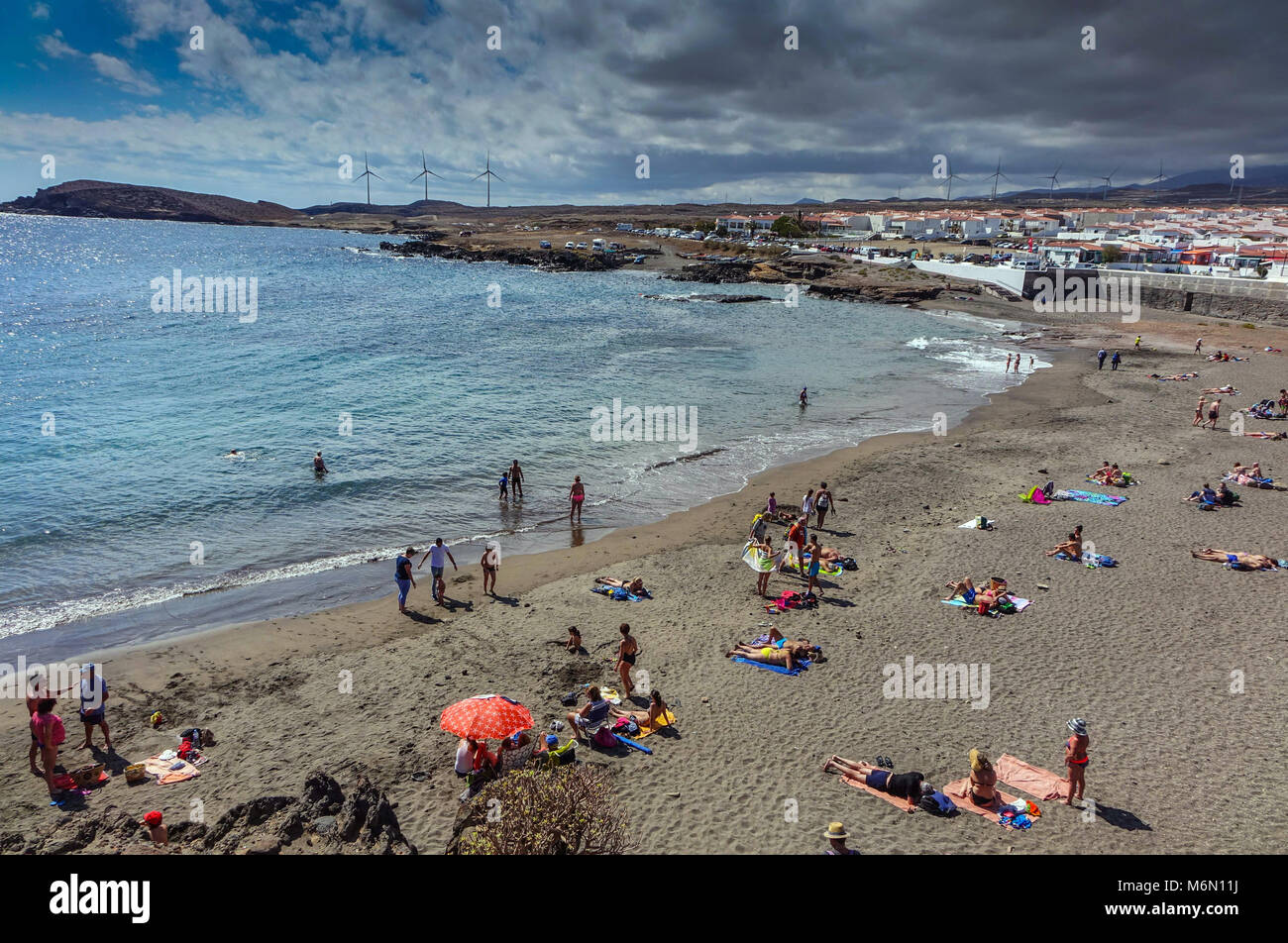 Abades beach, Poris de Abona, Tenerife South with family groups at the weekend - Stock Image