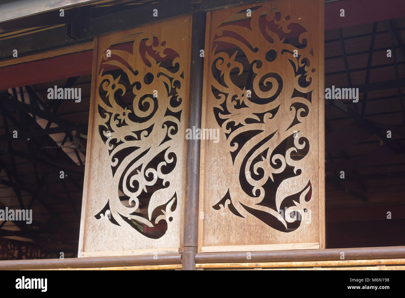 Traditional designs carved in wood sarawak cultural village stock