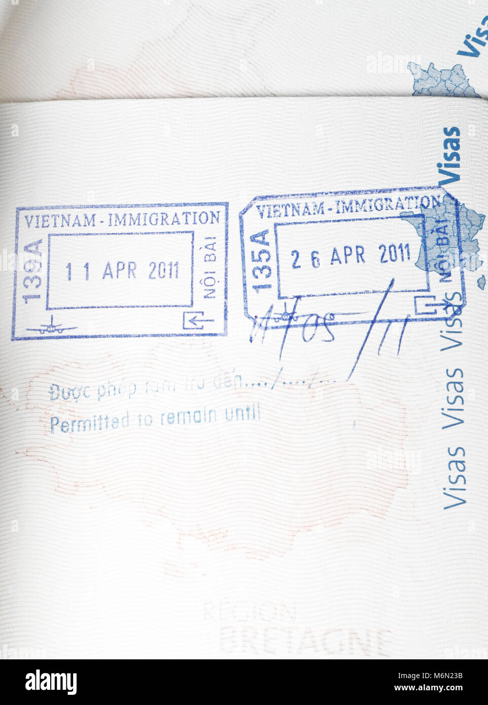 Inside cover of a French Passport with visa stamps - Stock Image