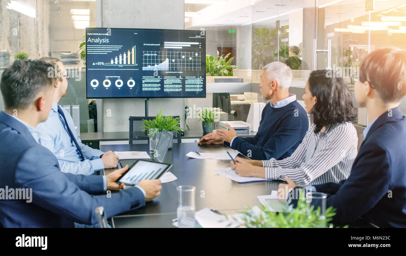 Board of Directors Has Annual Meeting, Diverse Group of Business People in the Modern Conference Room Discuss Statistics - Stock Image