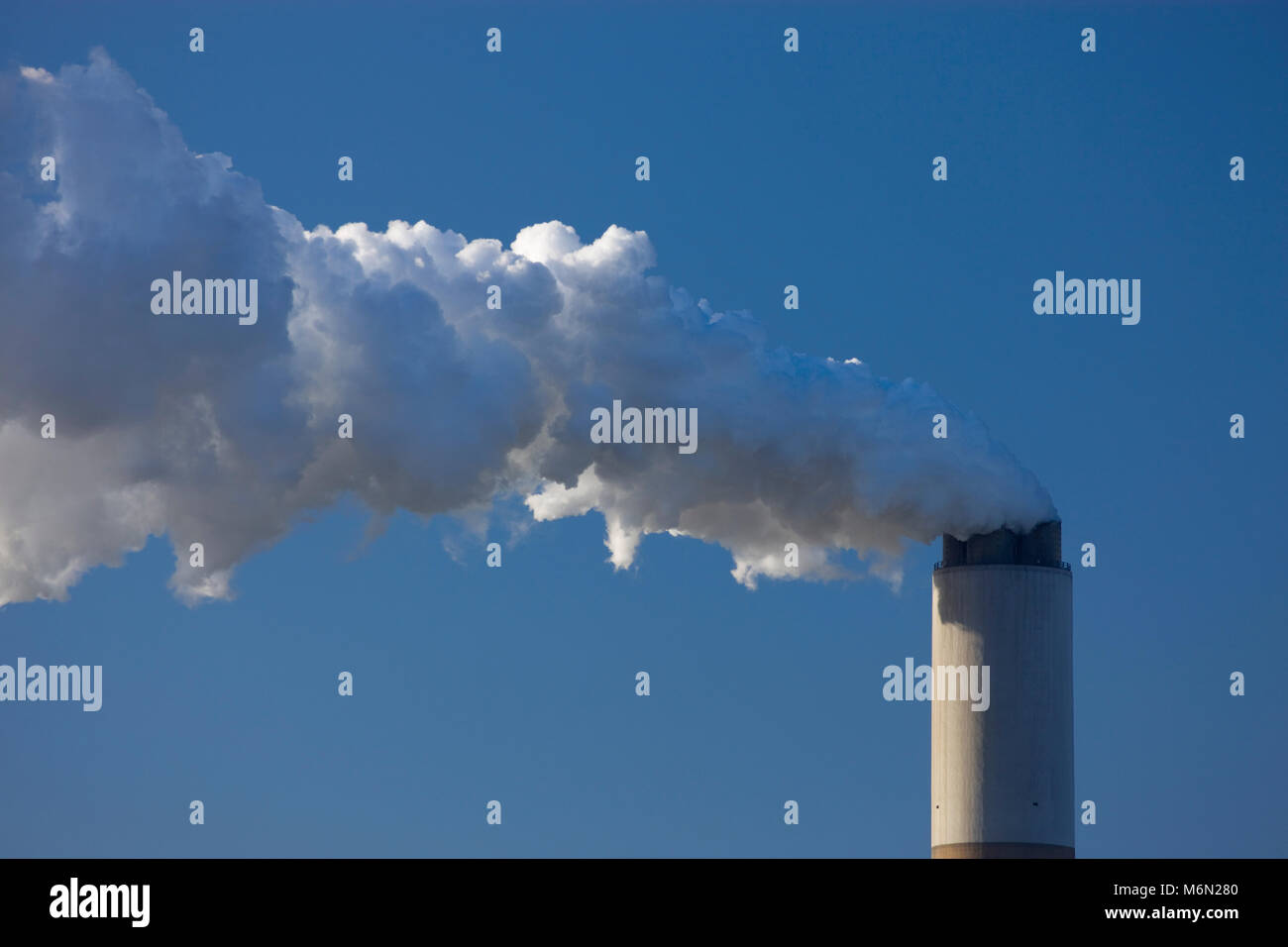 Steam from factory chimney stack  England - Stock Image
