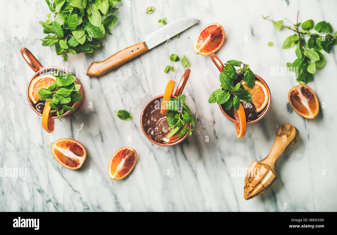 Blood orange Moscow mule alcohol cocktails, marble background - Stock Image