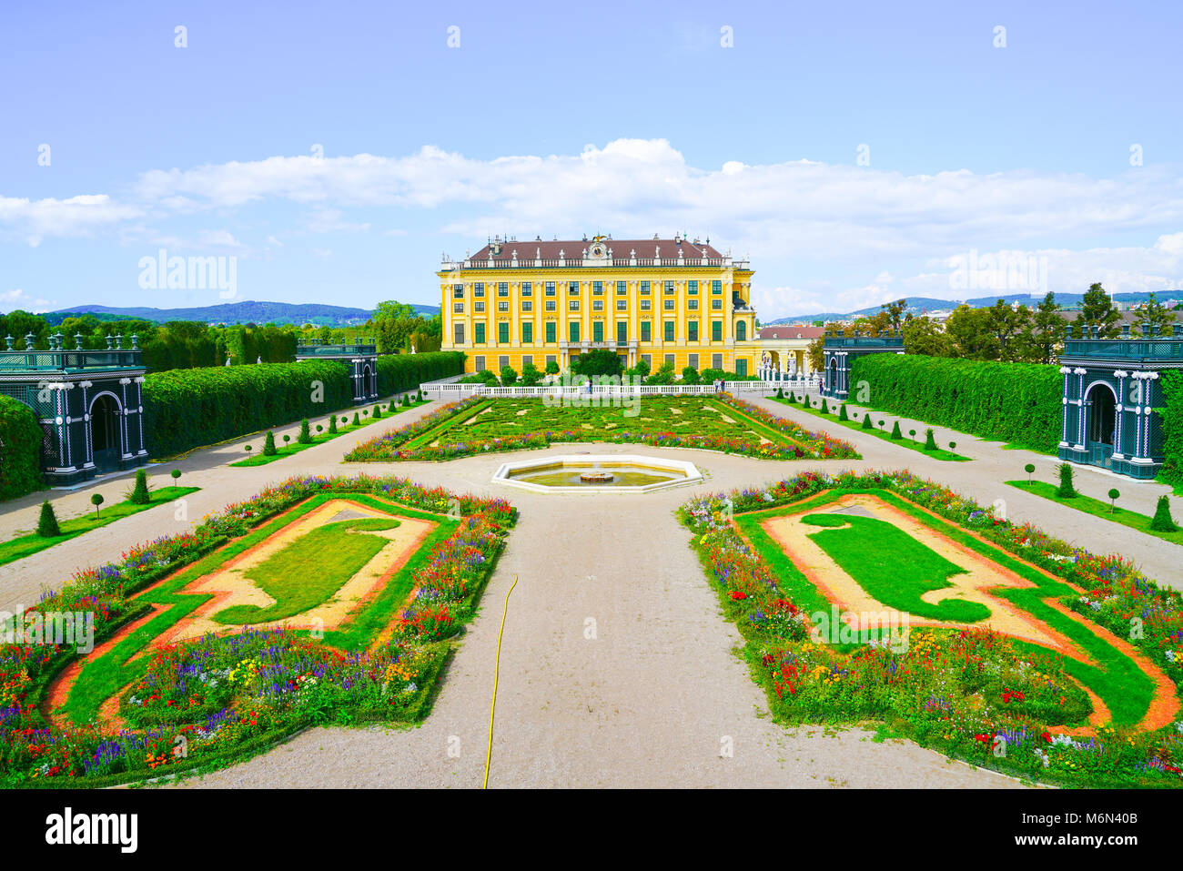 VIENNA,AUSTRIA - SEPTEMBER 4 2017; Formal gardens and paths to Baroque architectural detail of the Schonbrunn imperial - Stock Image