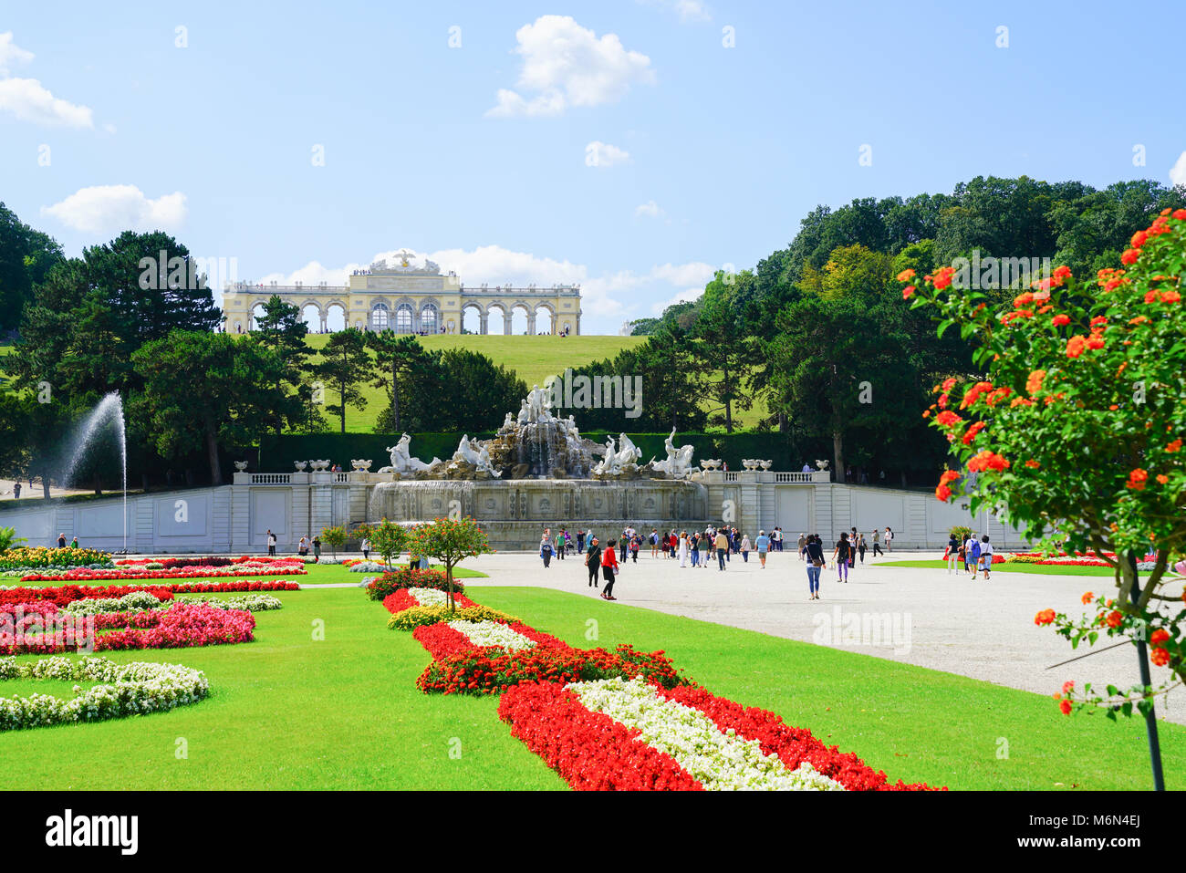 VIENNA,AUSTRIA - SEPTEMBER 4 2017; Landscape of formal gardens leading to Neptune Fountain and Gliorriete baroque - Stock Image