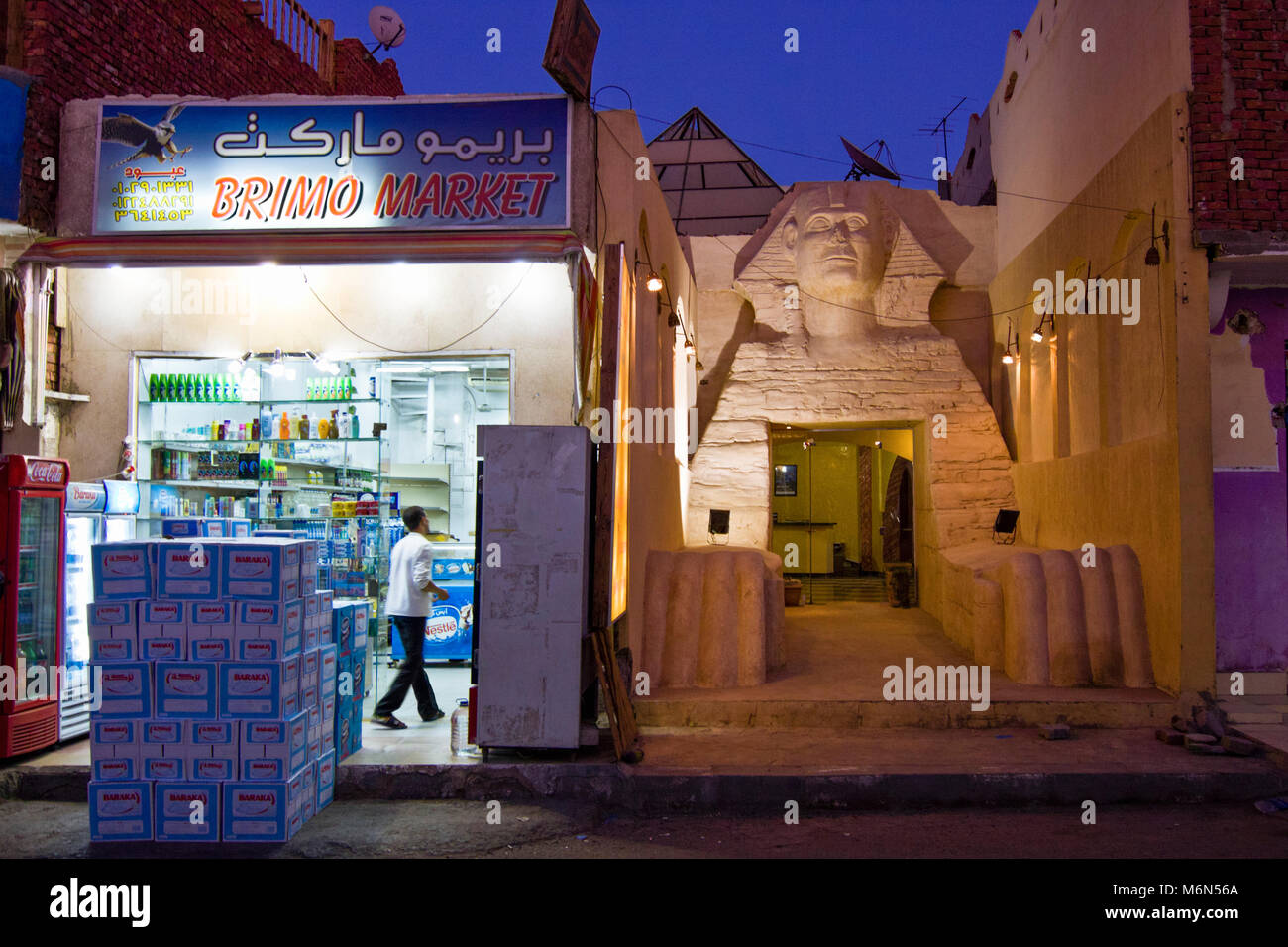 Hotel with big Giza Sphinx replica facade next to grocery shop in the Red Sea town of Dahab in South Sinai, Egypt - Stock Image