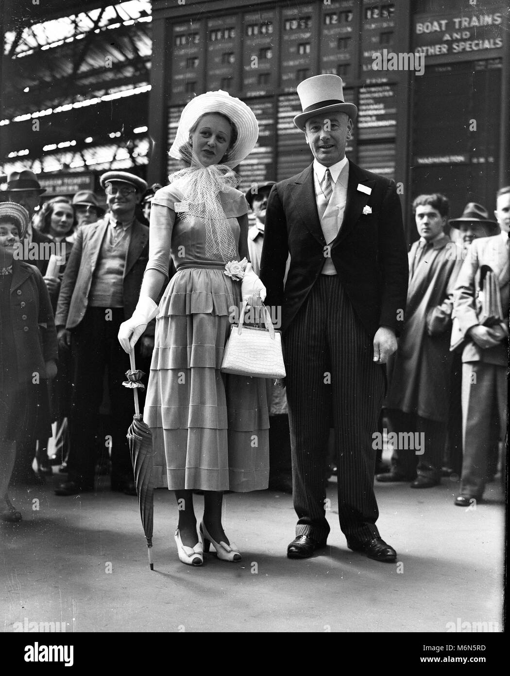 Turning heads on their way to  Royal Ascot 1948 Mr and Mrs Norman Coppock dressed in style for a day at he races. - Stock Image