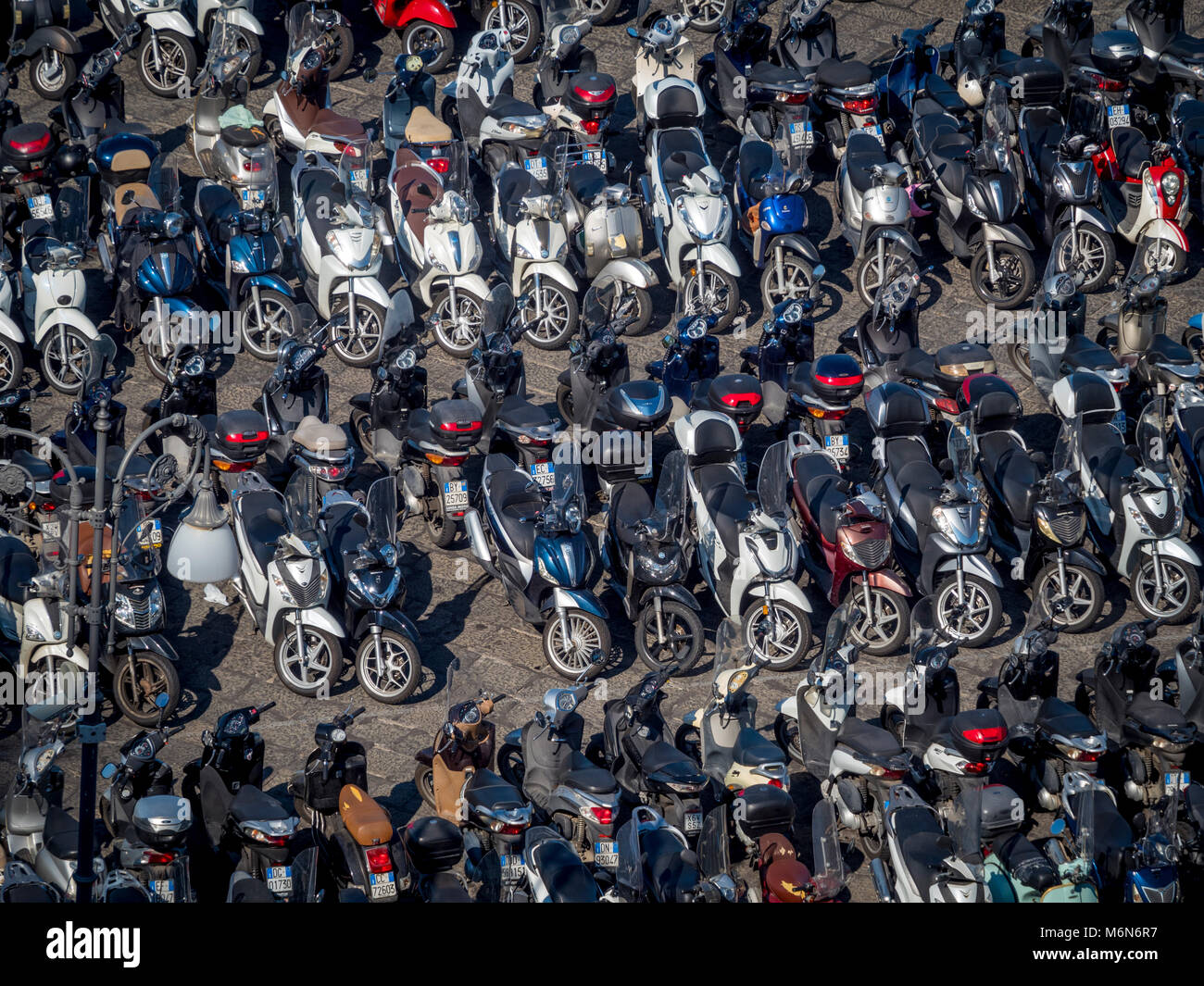 Motorbikes and mopeds in car park seen from above - Stock Image