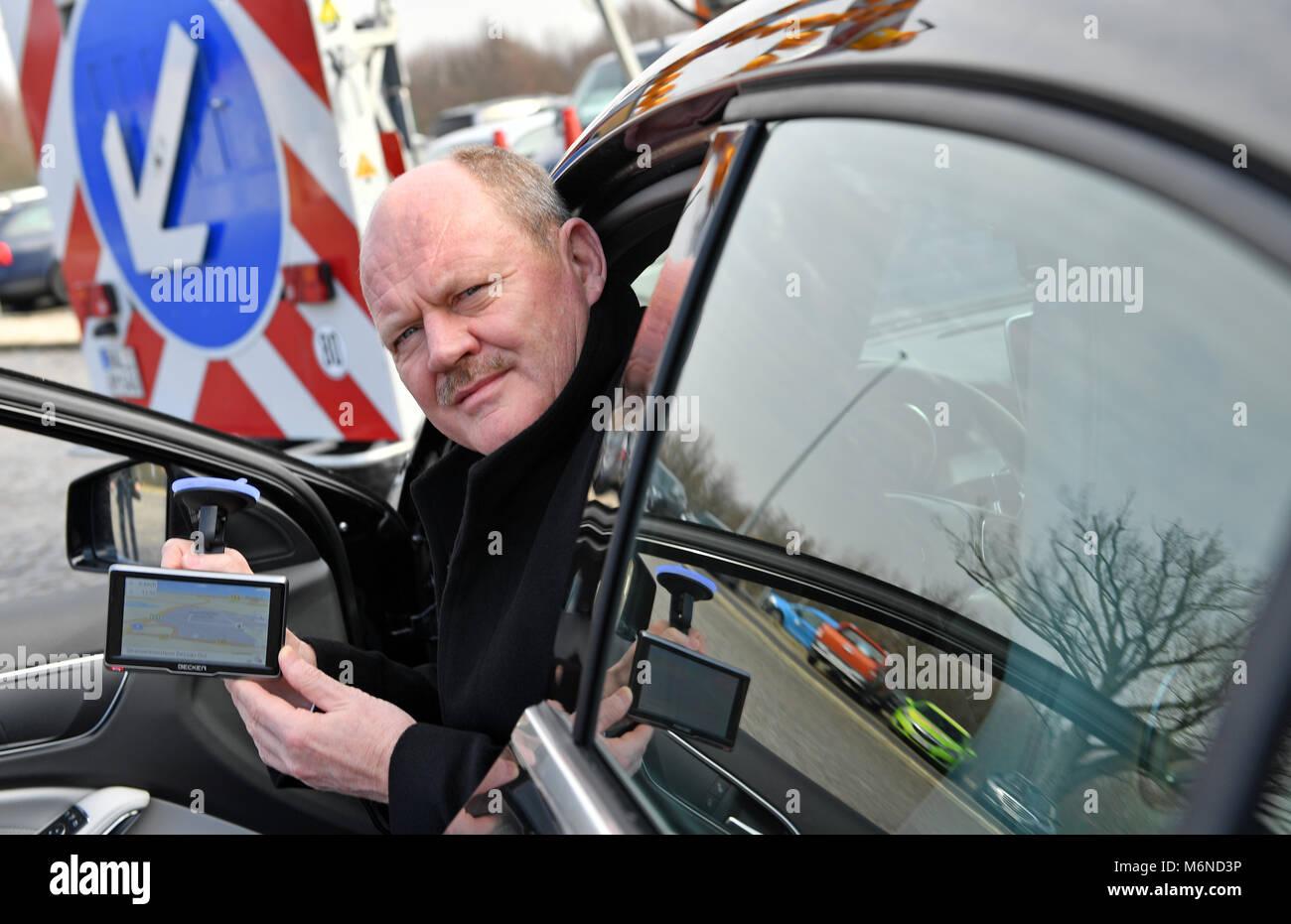 05 March 2018, Germany, Dessau-Rosslau: Thomas Webel (CDU), State Minister of Transport, holds a navigation system - Stock Image
