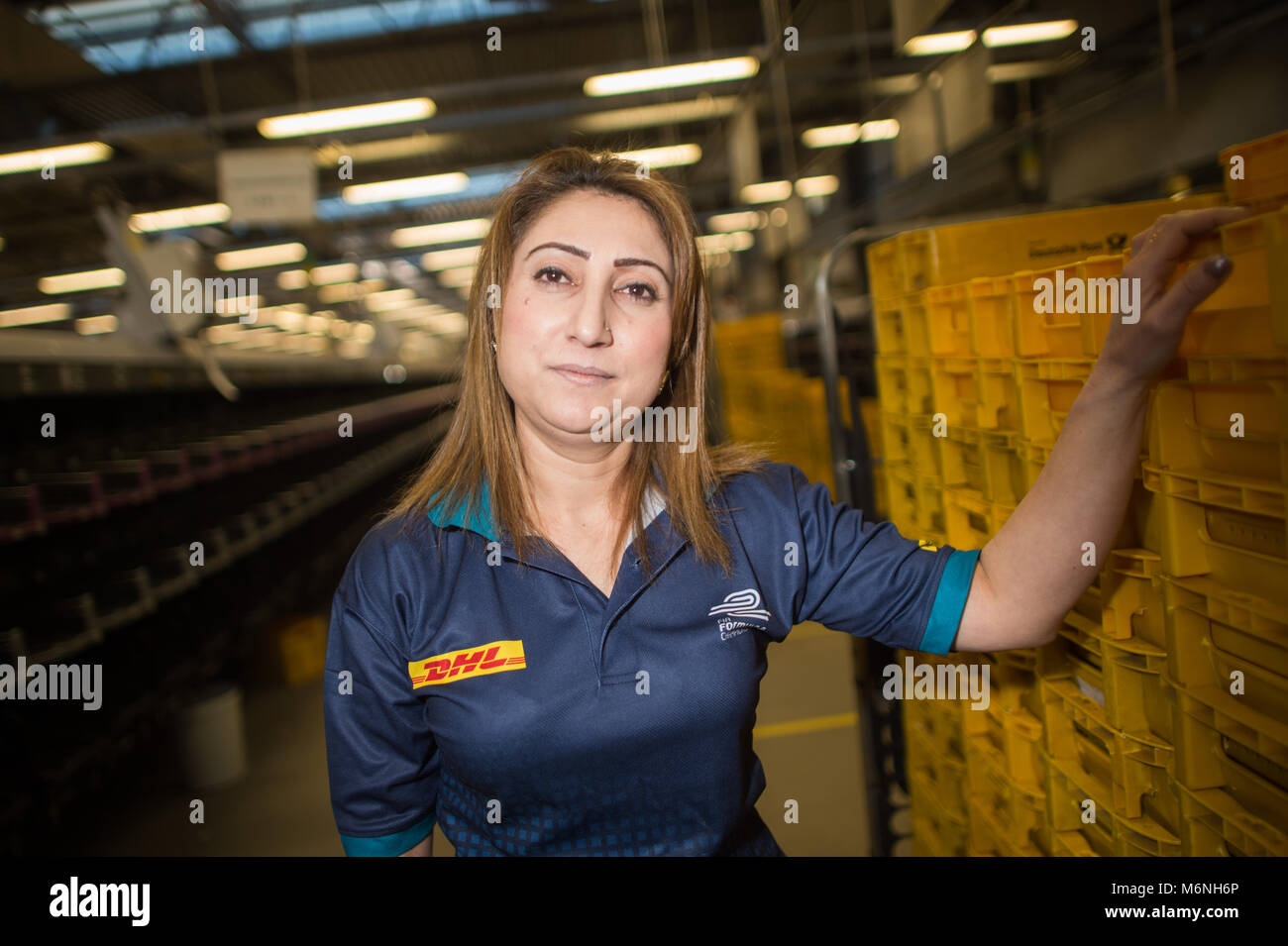 22 February 2018, Germany, Osterweddingen: Durcan Iskan from Syria works at the mail centre of the Deutshe Post Stock Photo