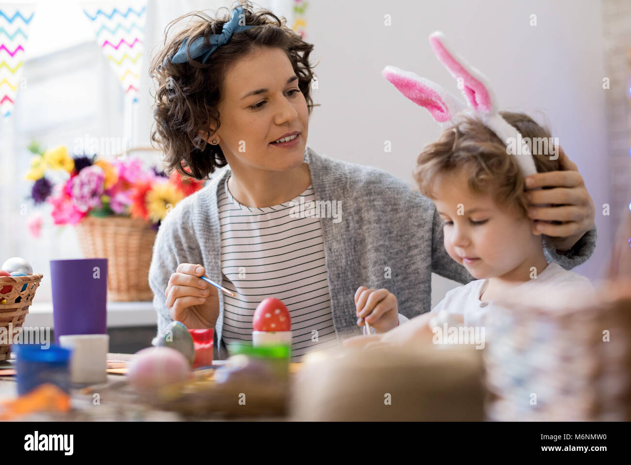 Mother and Son Painting Easter Eggs - Stock Image