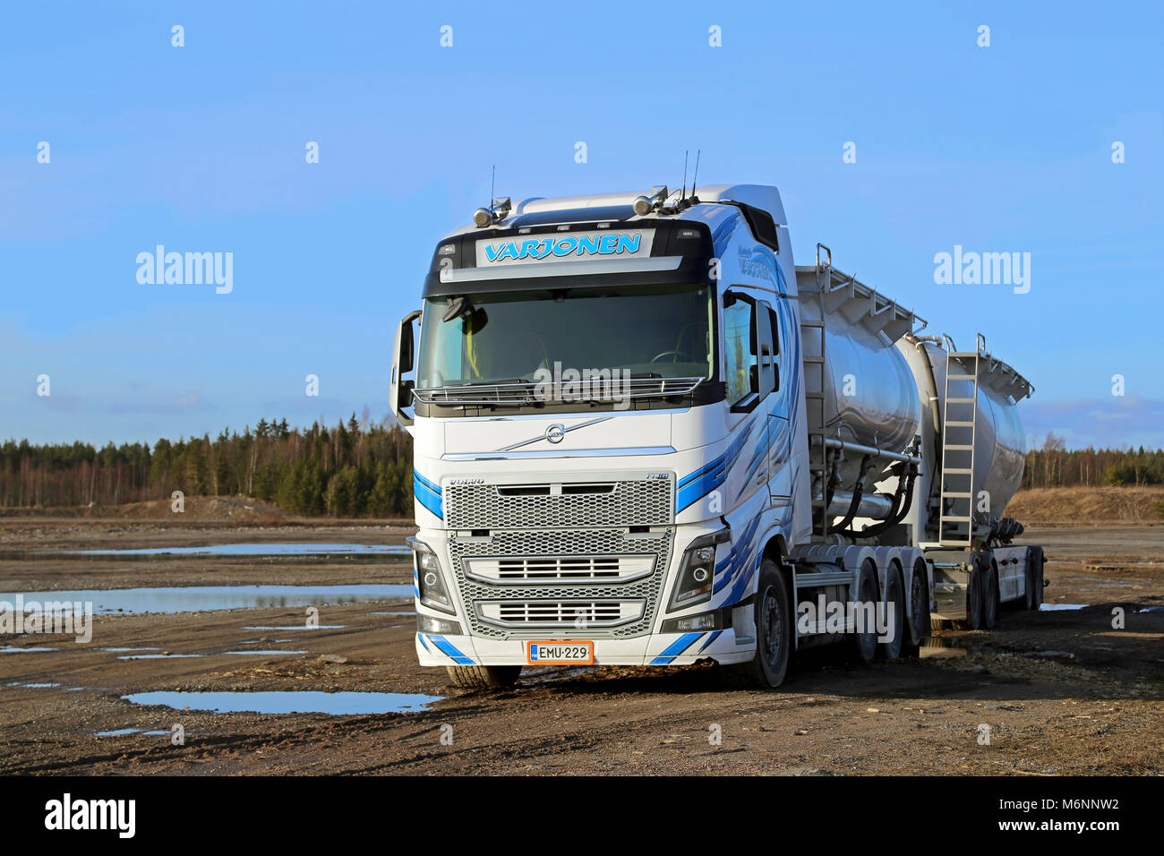 LIETO, FINLAND - MARCH 22, 2014: White Volvo FH tanker truck in dramatic landscape. The first Euro 6 versions of - Stock Image