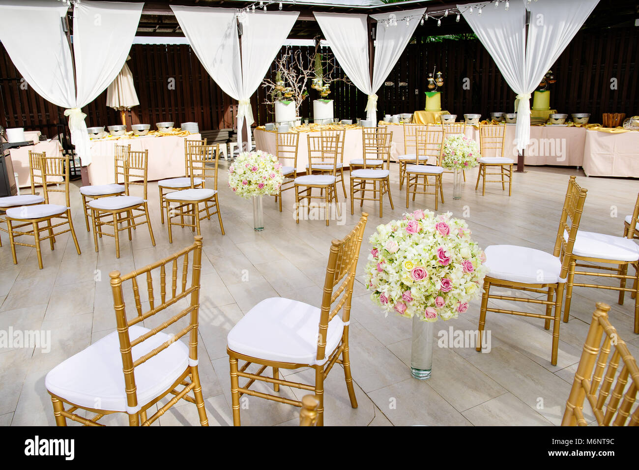 The Guest Chairs In Gold Color Theme With White Cover The Beach Stock Photo Alamy