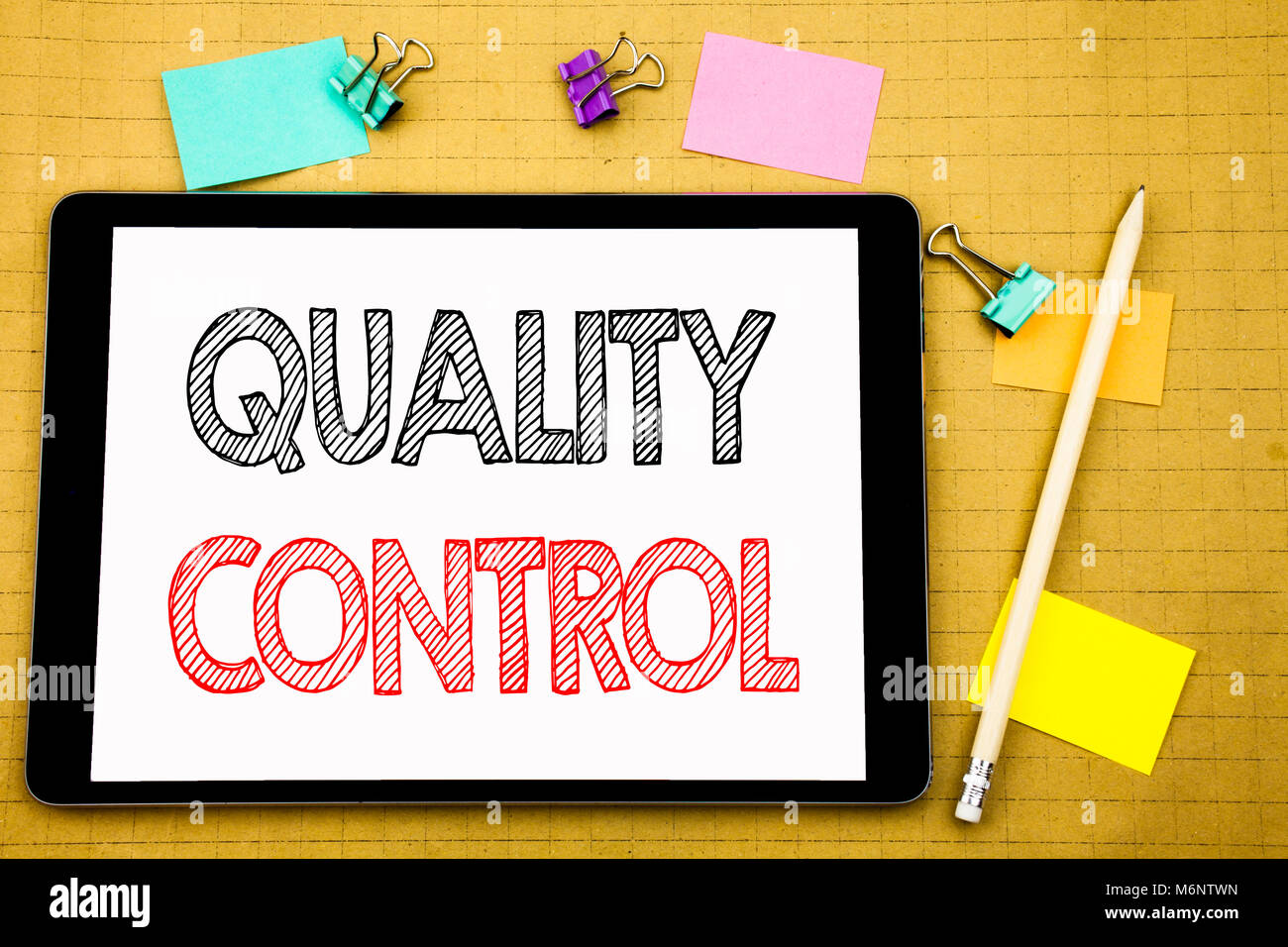 Word, writing Quality Control. Business concept for Improvement Work Written on laptop, wooden background with sticky - Stock Image