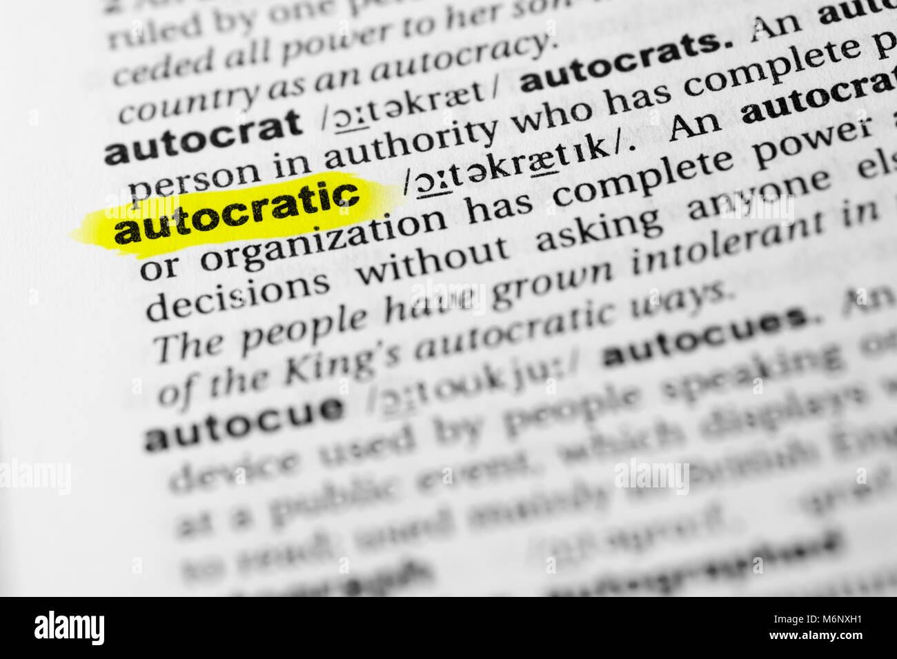 Highlighted English word 'autocratic' and its definition in the dictionary. - Stock Image