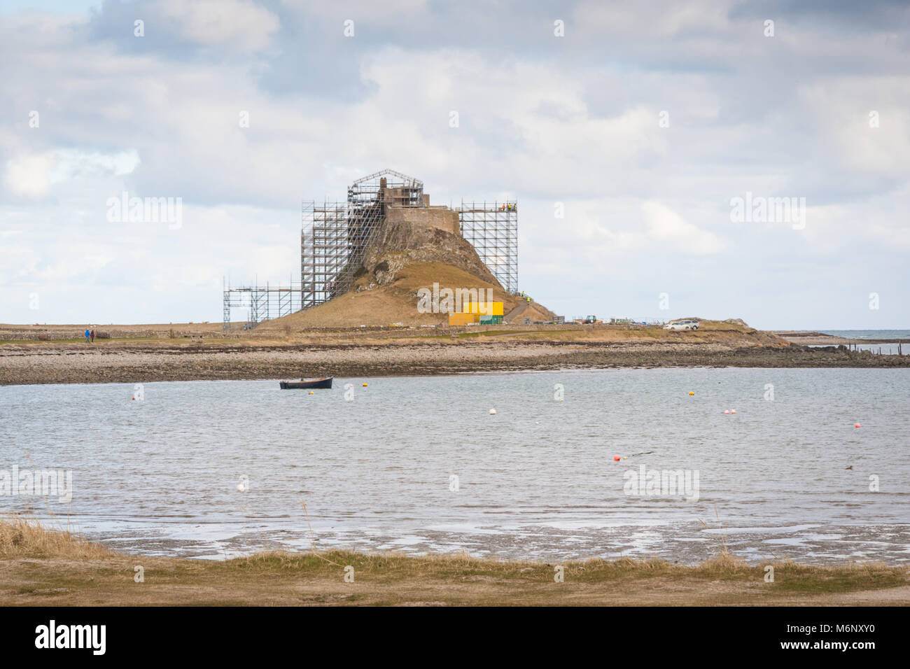 Lindisfarne Castle with scaffolding fixed to its exterior for repairs UK - Stock Image