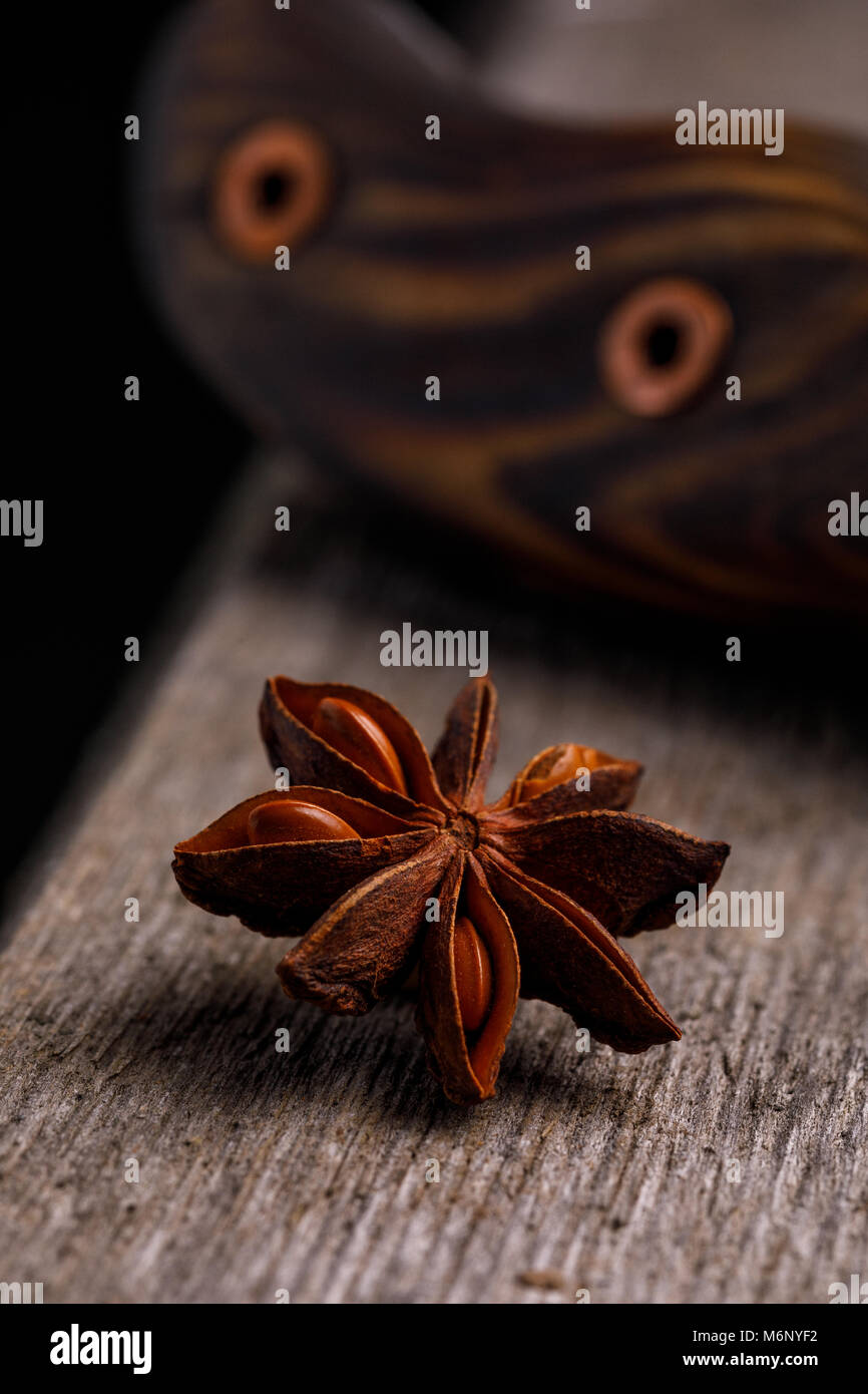 A badge on a wooden background. Approach for beautiful dishes. - Stock Image