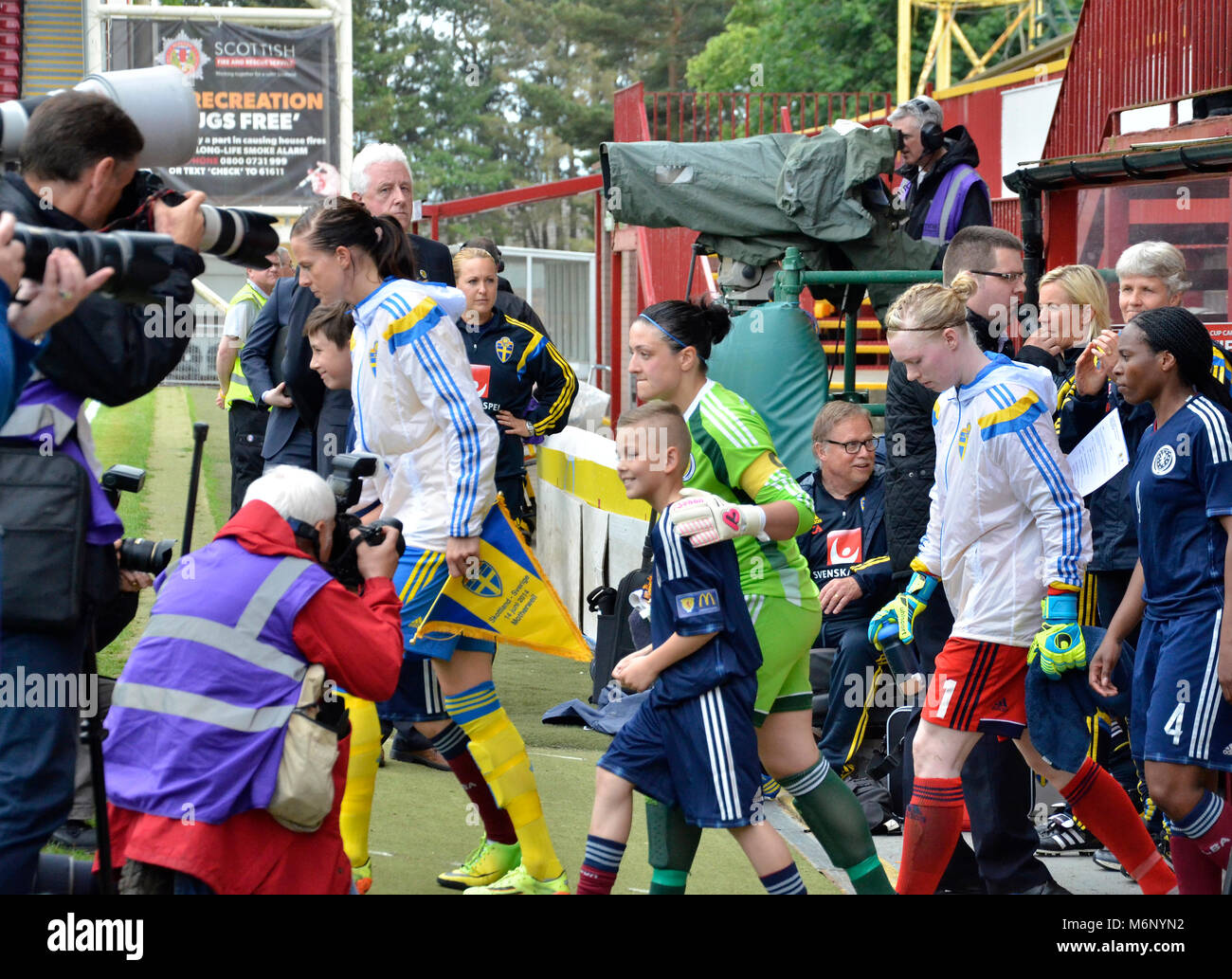 MOTHERWELL, SCOTLAND - JUNE 14th 2014: The Scotland and Sweden's national football team come out of the tunnel in Stock Photo