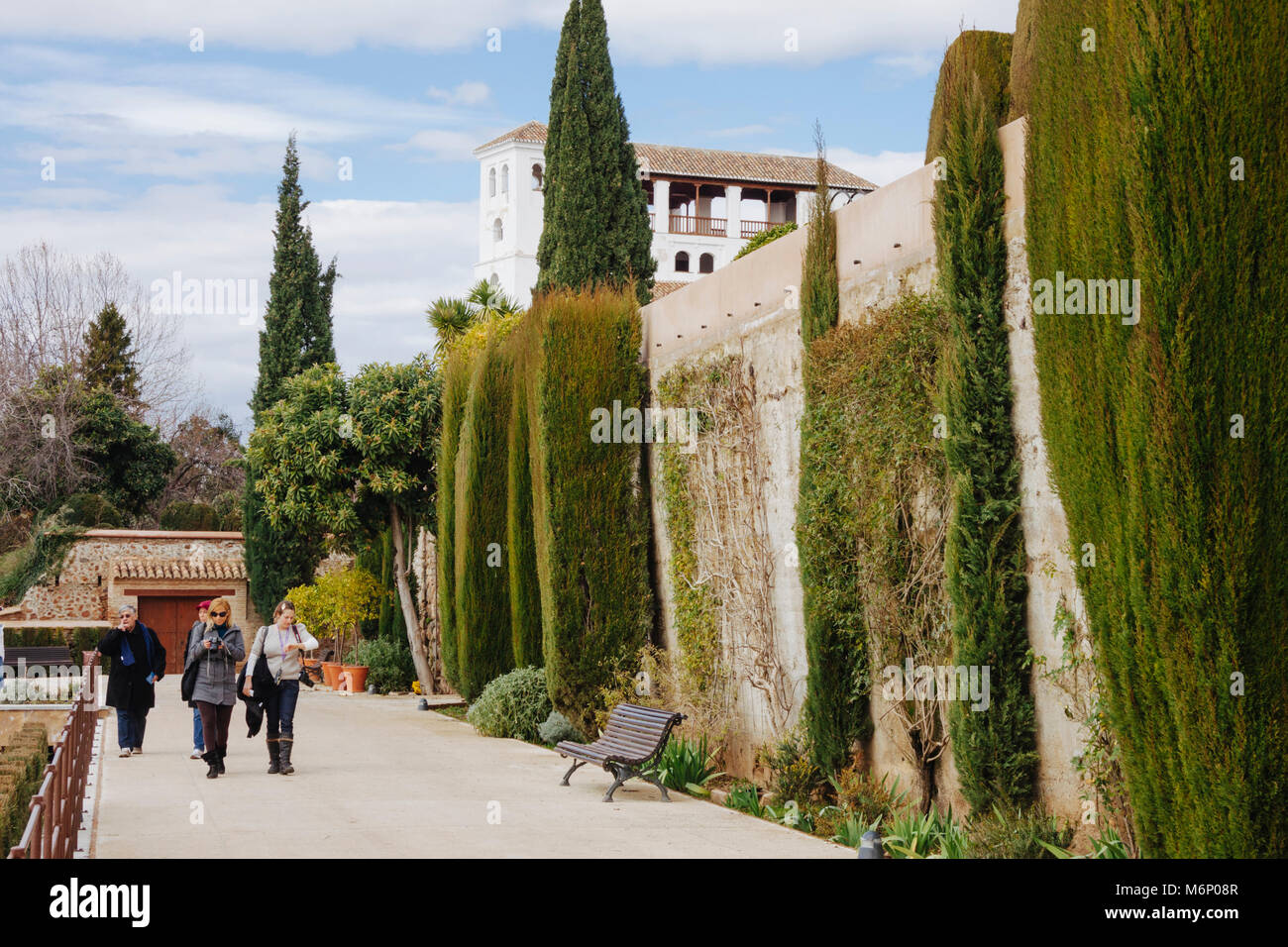 Granada, Andalusia, Spain : Tourists walk in the gardens of the Generalife palace inside the Alhambra and Generalife complex. Stock Photo