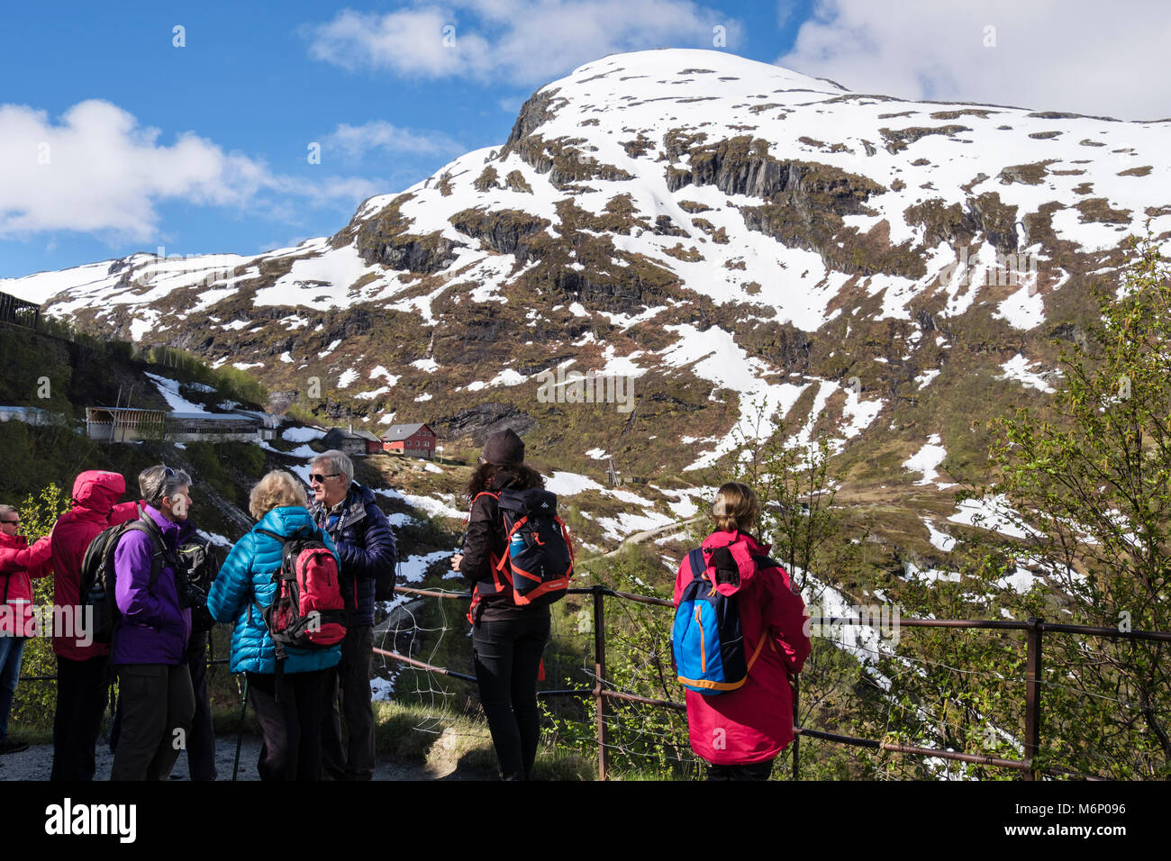 People looking at a view down a valley from a viewpoint below Flam Railway. Vatnahelsen, Aurland, Norway, Scandinavia, - Stock Image
