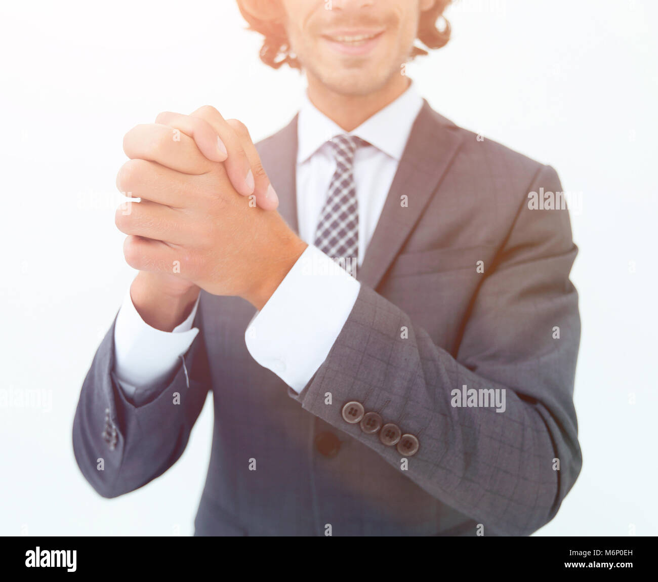 portrait of bearded business man rubbing his hands together - Stock Image
