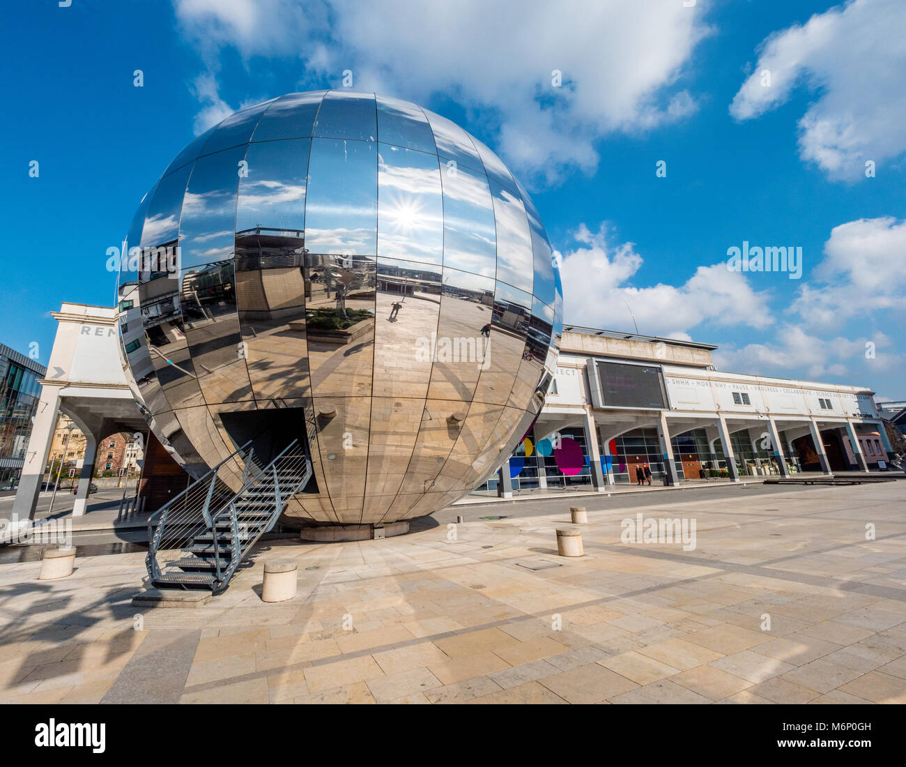 Millennium Square in Bristol UK with the Planetarium in the form of a huge walk-in mirror ball dominating the large - Stock Image