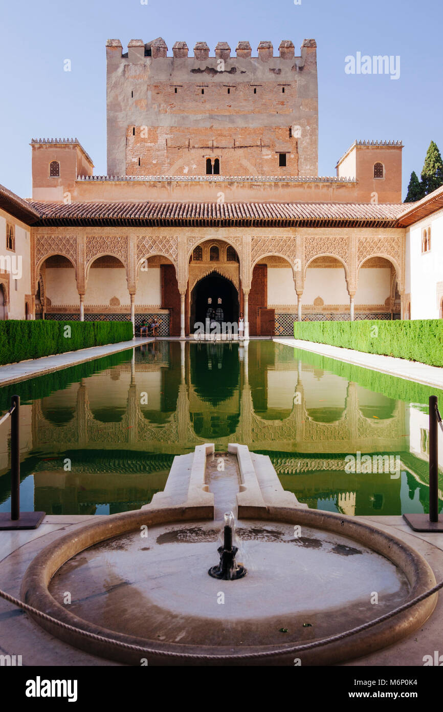Granada, Andalusia, Spain - July 18th, 2010 : Tower of Comares and reflecting pool in the Court of the Myrtles (Patio - Stock Image