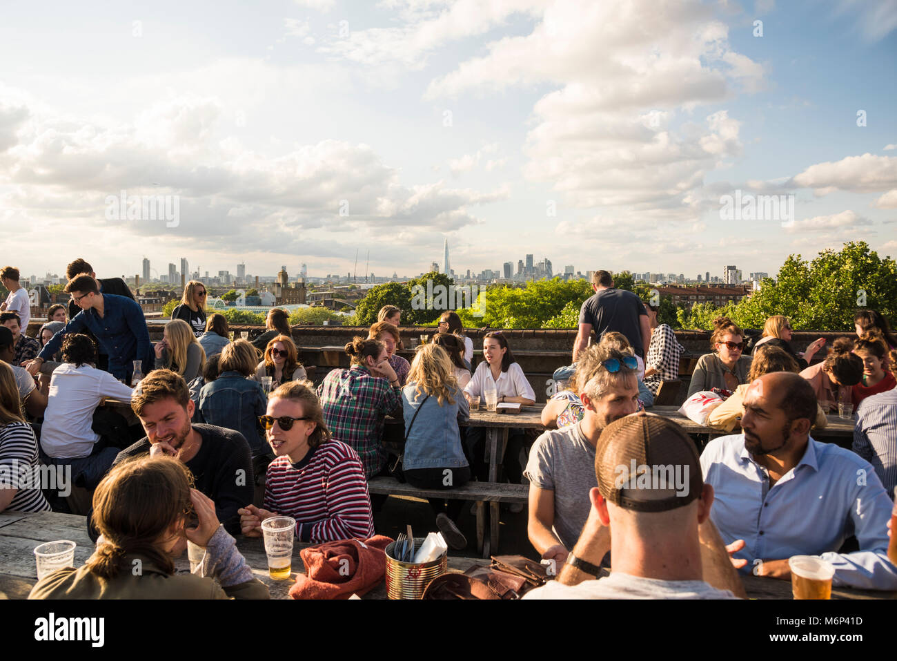 People socialising and enjoying a drink together at Franks Cafe outdoor rooftop bar with spectacular view of the - Stock Image