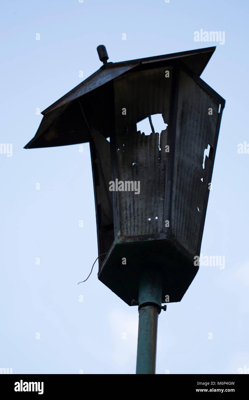 Broken hooligans street lamp Stock Photo