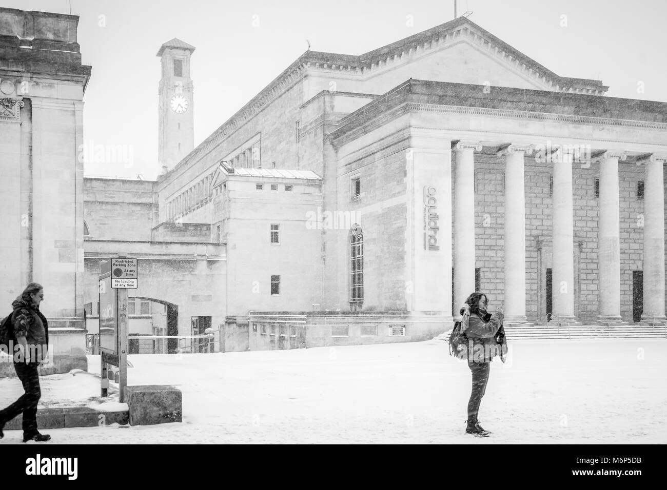 Monochrome of the O2 Guildhall and the Civic Centre Clock Tower in Guildhall Square during heavy snowfall in Southampton, - Stock Image