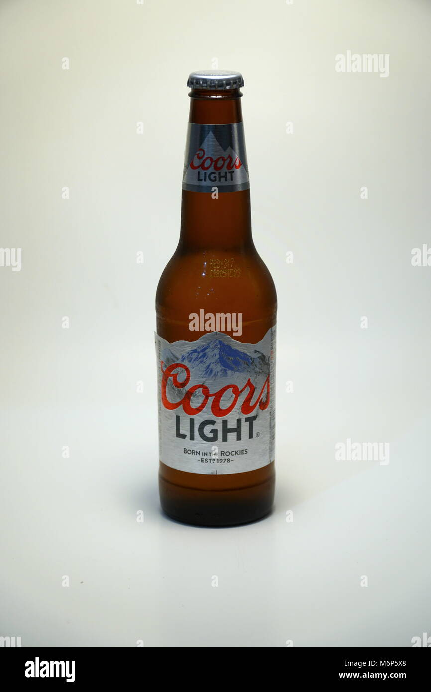 Coors light beer bottle against white background product shot stock coors light beer bottle against white background product shot silver bullet alcoholic drink branded cold as rocky mountains in colorado brewed in u aloadofball Image collections