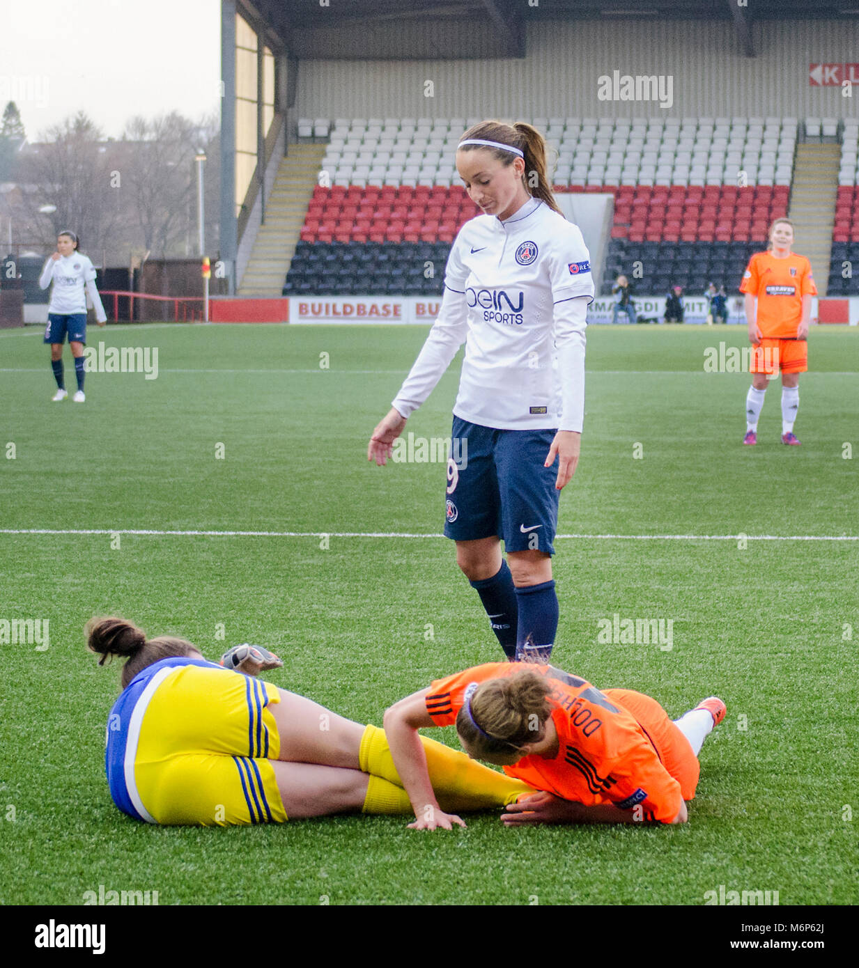 AIRDRIE, SCOTLAND - MARCH 22nd 2015: PSG player, Kosovare Asllani looks down at two Glasgow city players. - Stock Image